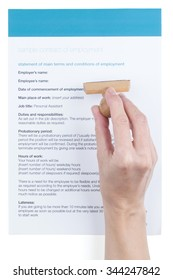 female hand puts a stamp in the employment contract
