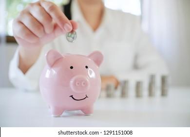 female hand saving money for future retirement plan.