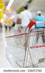 Female hand and shopping trolleys