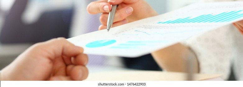 Female hand showing financial report paper to customer closeup