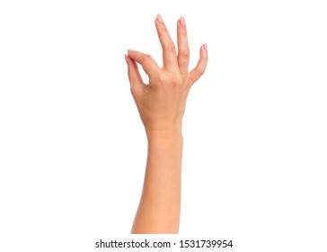 Female hand showing OK gesture, isolated on white background. Beautiful hand of woman with copy space.