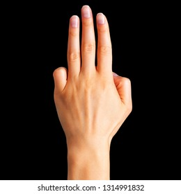 Female hand showing three fingers, swear sign or multitouch gesture on black background. on black background