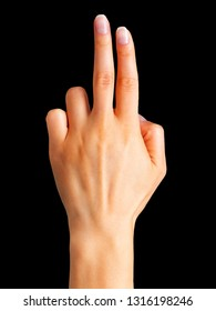 Female hand showing three fingers, swear sign or multitouch gesture on black background. Isolated with clipping path.