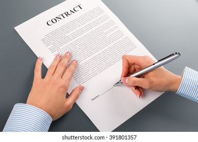 Female hand signs cooperation contract. Lady signing cooperation contract. We will become stronger. Never doubt and never hesitate.