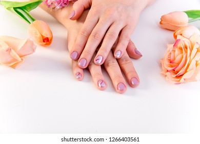 female hand skin care - hands holding flowers