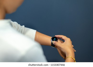 Female hand with smartwatch and health application,Health concept background.