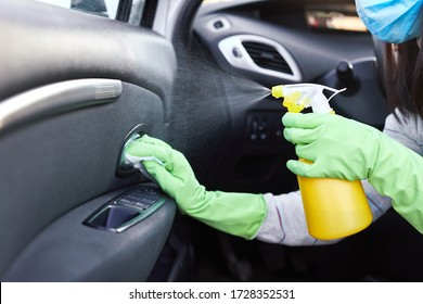 Female hand spraying sanitizer and antiseptic wet wipes for disinfecting car. Cleanliness during Corona virus, COVID-19.