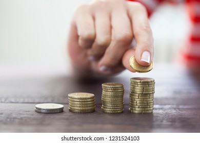 Female hand stack coins to shown concept of growing business and wealthy. Saving money concept