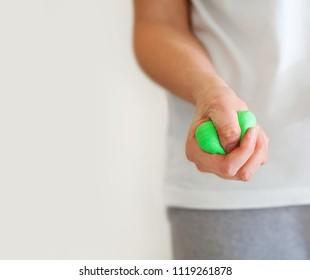 Female hand stimulation using exercise putty manufacturer