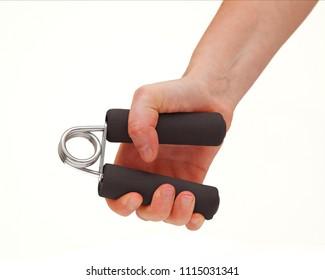 Female hand stimulation using grip strenghtener on white background
