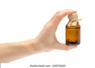 female hand takes or gives homemade medicine. Isolated on white background