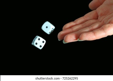 Female Hand Throwing Dice On Black Background