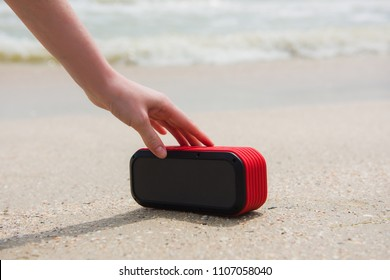 Female hand touch portable speaker
