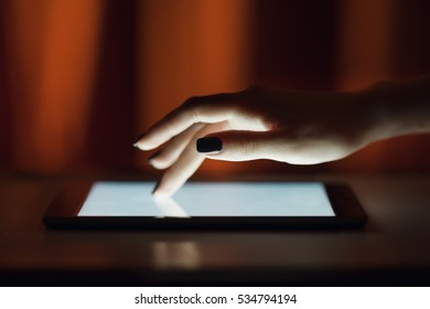 Female hand touching digital tablet , text messages, video calls, holidays to work, using the Internet