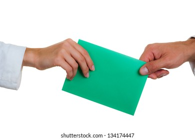 female hand transfers an envelope of green color to the man's hand, isolated on a white background