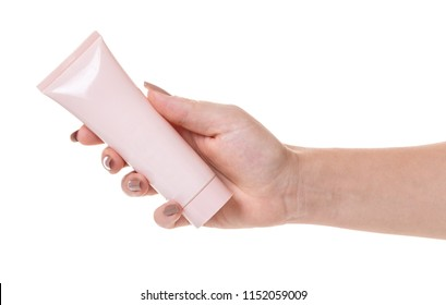Female hand with a tube of cosmetic cream on white isolated background