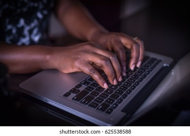 Female Hand typing on Laptop