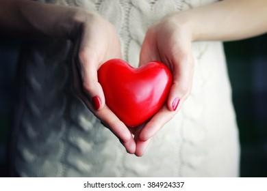 female hand valentine heart