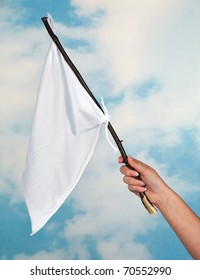 Female hand waving with a white flag to surrender