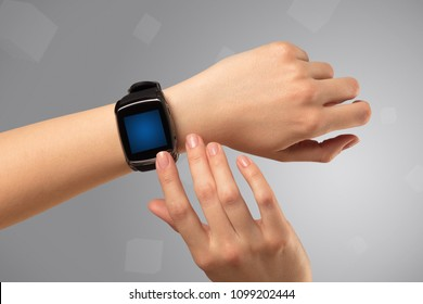 Female hand wearing smartwatch with free space on the screen