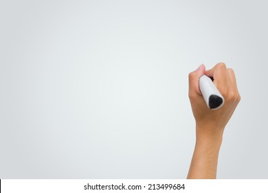 Female hand writing with marker on white background