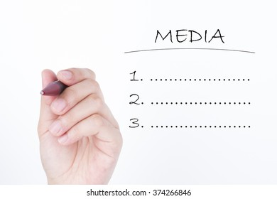 A female hand writing word MEDIA isolated on a pure white background