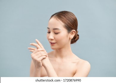 female hands applying hand cream