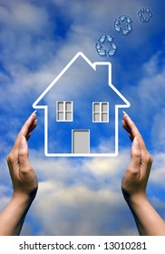 female hands around a house icon with blue recycling symbols coming out of chimney
