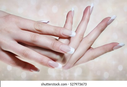 Female  hands with beautiful french manicure