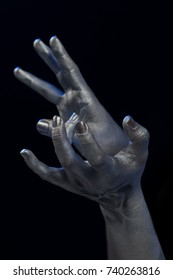 Female hands bodyart. Silver skin with a black pattern.