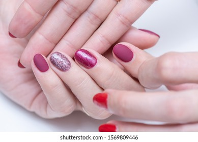 Female hands close-up with a beautiful manicure on a white background. Gel polish in a beauty salon