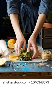 Female hands are cooking asparagus. The concept of healthy diet