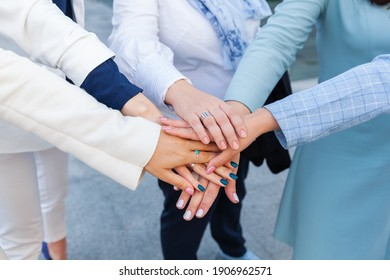 female hands dash together against a background of cold shades.