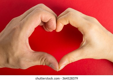 Female hands do hands heart on valentine day.