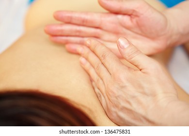 Female hands doing  rubbing while spa massage