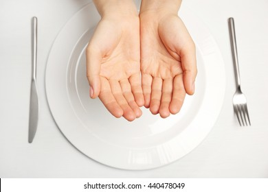 Female hands and empty plate on white background