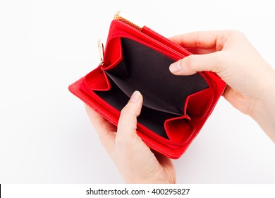 Female hands with an empty wallet on white background