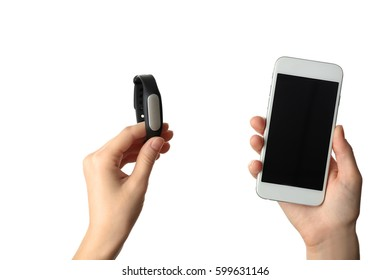 Female hands with fitness tracker and smart phone on white background