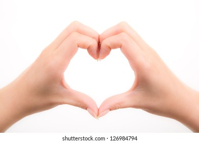 Female hands in the form of heart on white background