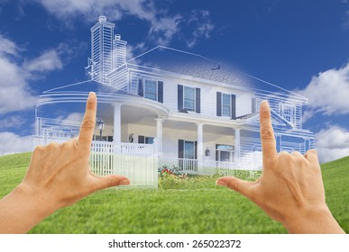 Female Hands Framing Beautiful Custom House Design Drawing and Ghosted House Above Grass Field.