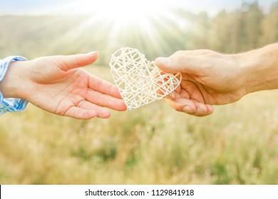 Female hands giving heart love friendship