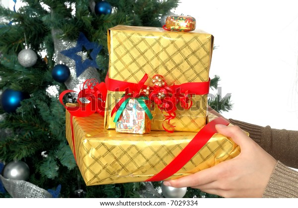 Female hands giving a New Year presents