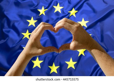 Female hands heart symbol with European Union flag in background