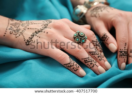 Female Hands Henna Tattoo On Blue Stock Photo Edit Now 407517700