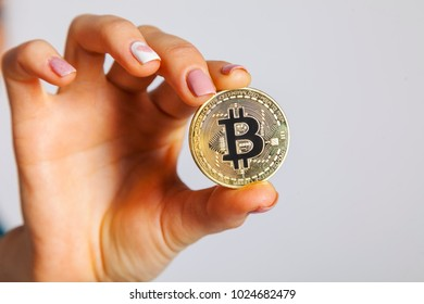 female hands hold bitcoin