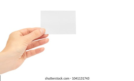 Female hands hold a business card. Isolated on white background. copy space, template.