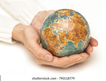 Female hands hold the Globe. Global concept.