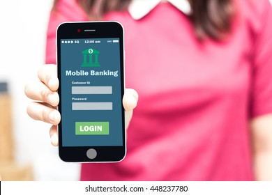 Female hands hold mobile banking on smart phone