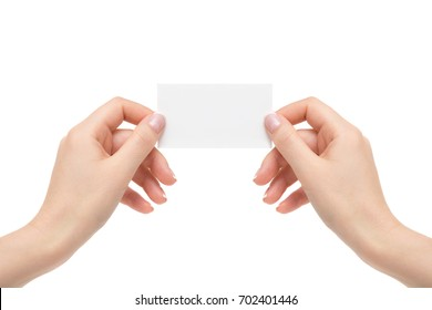 Female hands hold white card on a white background.