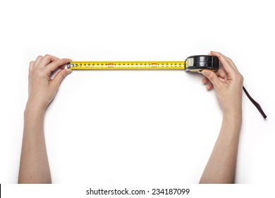 A female hands hold a yellow tape measure isolated white, top view at the studio.